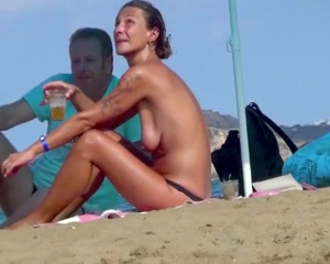 her first anal voyeur - Amateur topless woman at the beach voyeur filmed