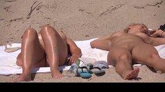 Two nudist girls filmed voyeur at the beach