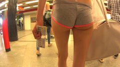 Candid camera hot girl in short pants walking in public