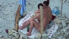 Nudist wife caught doing oral sex at the beach on voyeur cam
